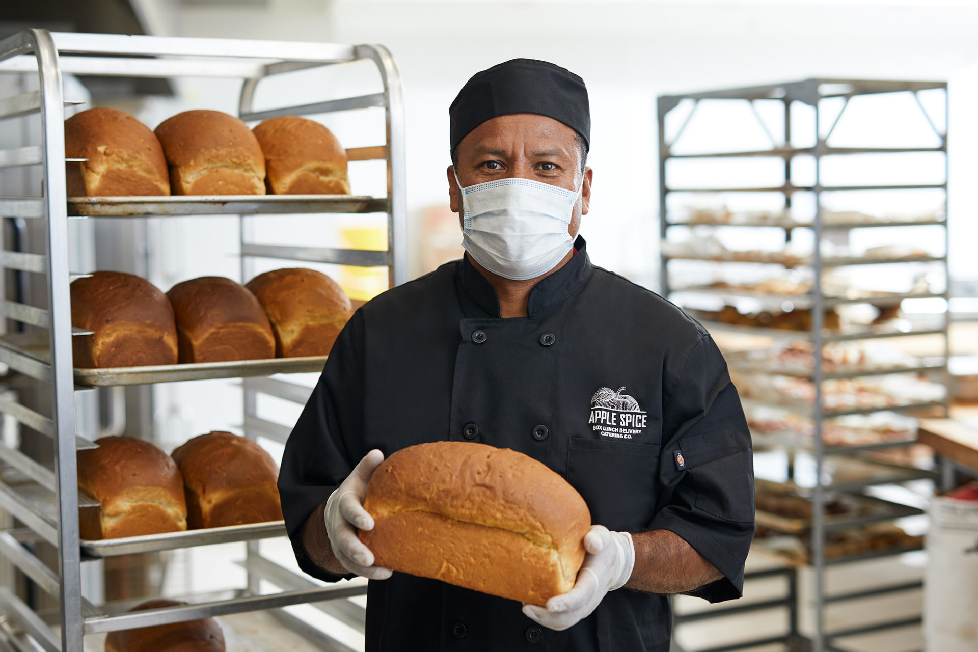 apple spice employee with fresh baked bread