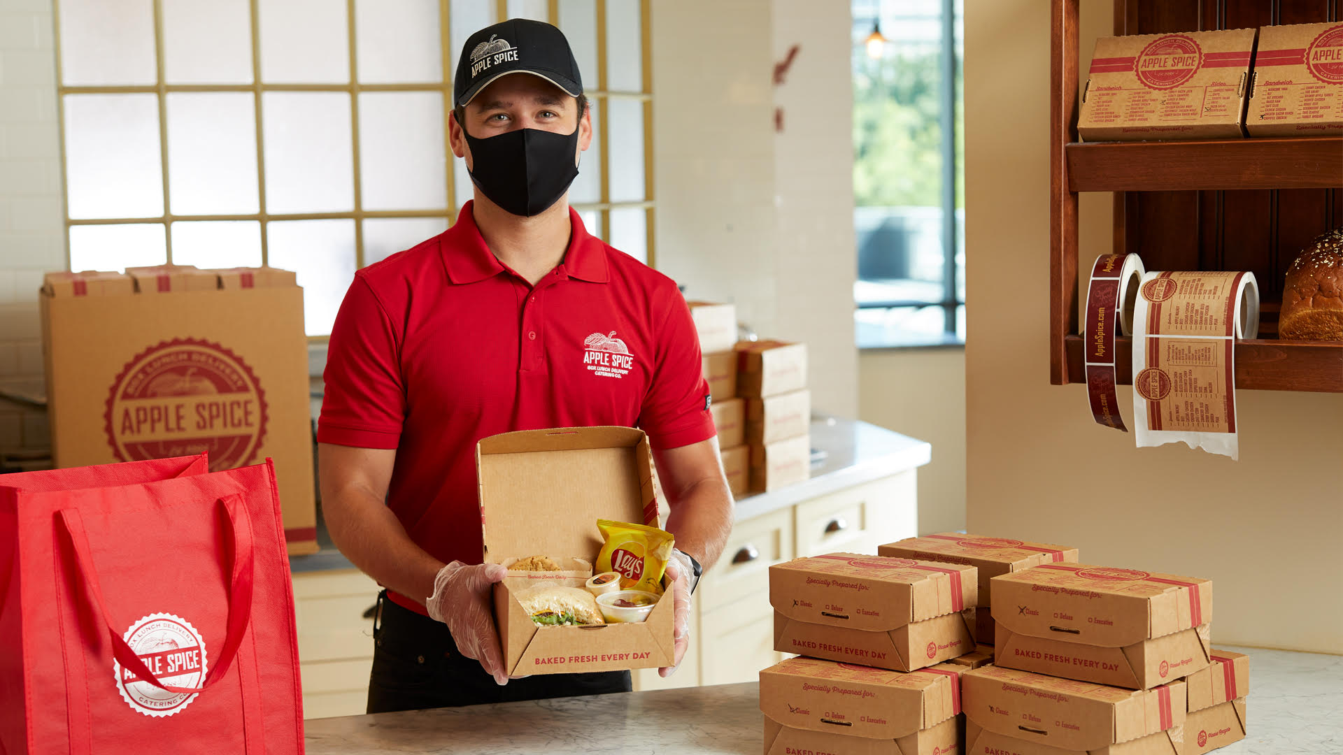 Apple Spice Staff holding Box Lunch Catering