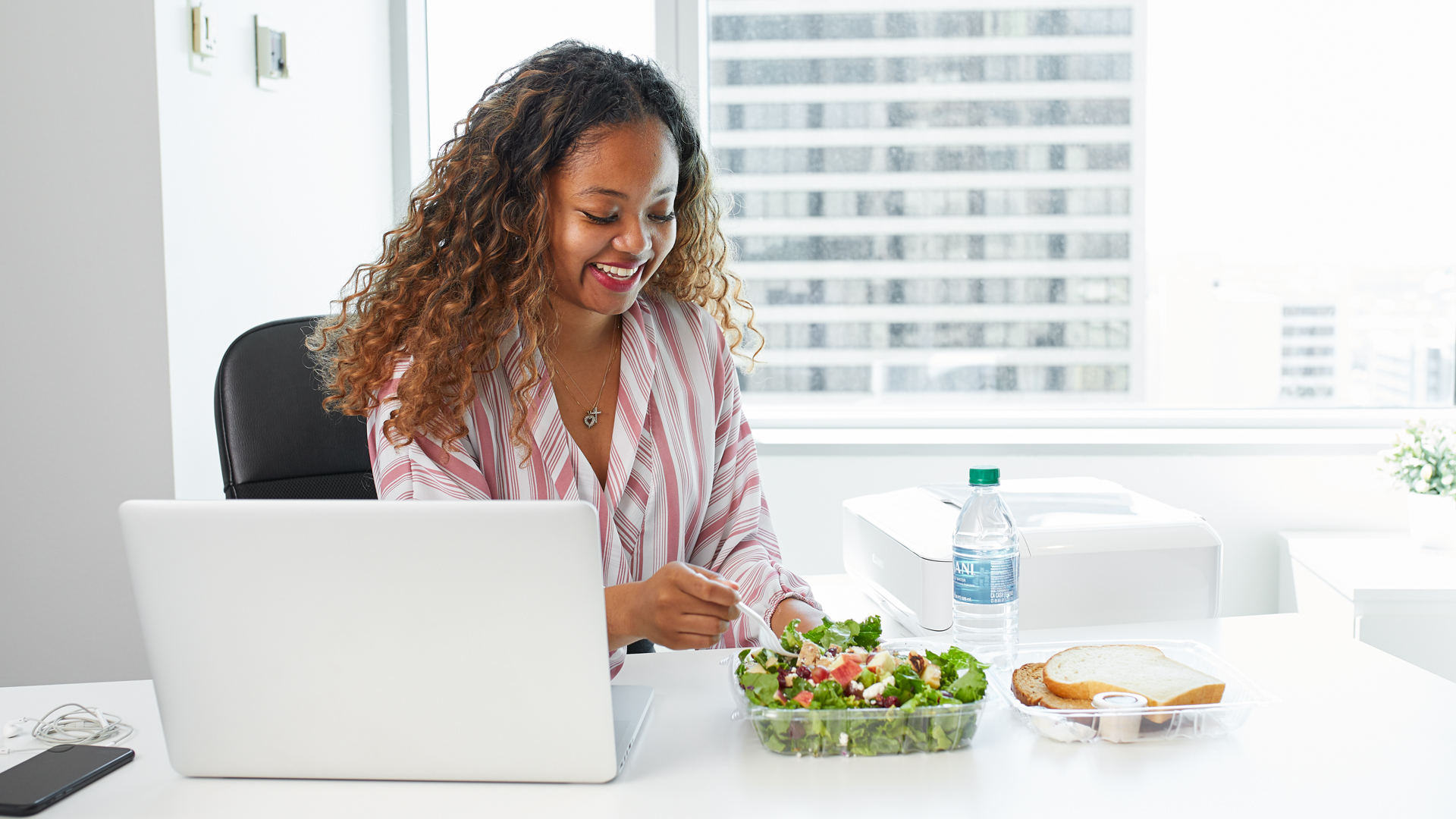 Office Employee Enjoying Apple Spice Catered Salad