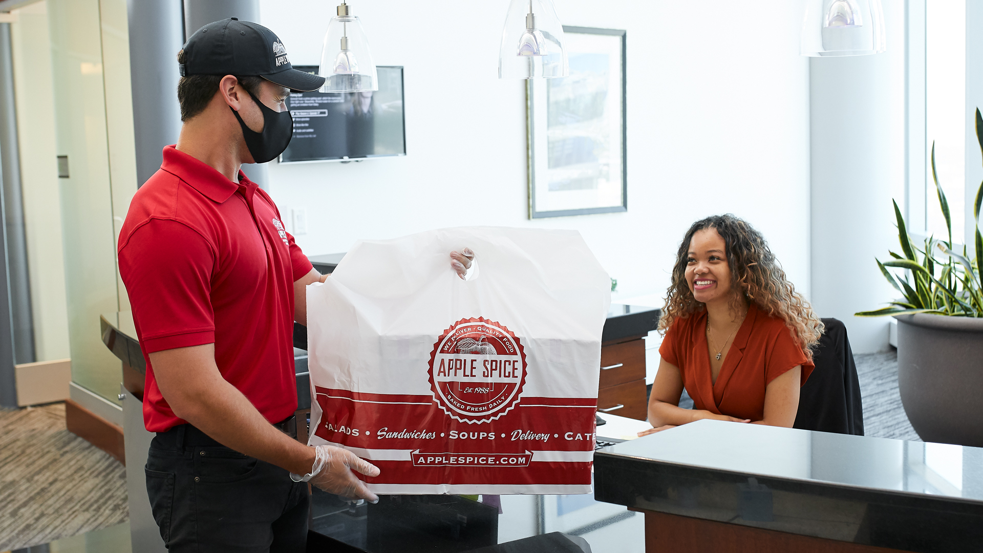 Apple Spice Catering Employee Delivers to Office for Catered Event